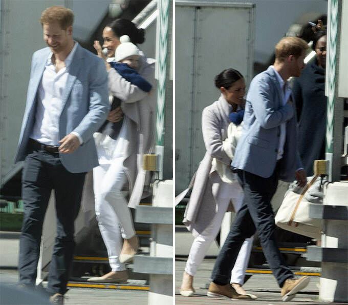 Adorable moment a shy young schoolboy gives Meghan Markle a huge hug as she and Prince Harry tour township dubbed South Africas murder capital while baby Archie stays behind with a nanny amid super-tight security - 1
