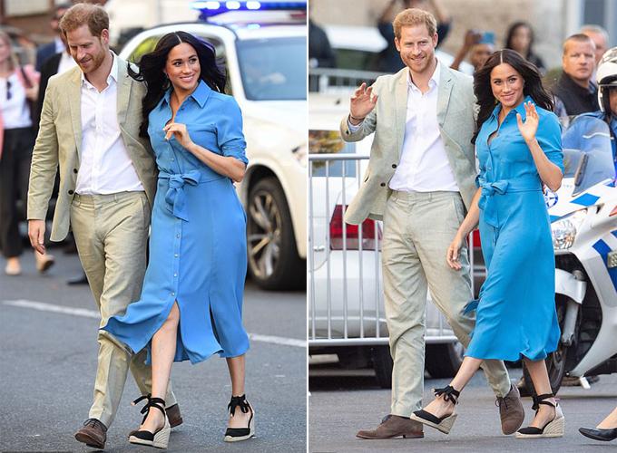 Hoàng tử Harry luôn nắm tay hoặc ôm eo vợ mọi lúc mọi nơi. Ảnh: AP.