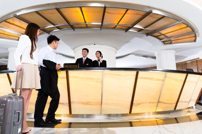 Phần lớn khách sạn quy định du khách phải trả phòng trước 12h và nhận phòng sau 14h. Ảnh: Shutter Stock