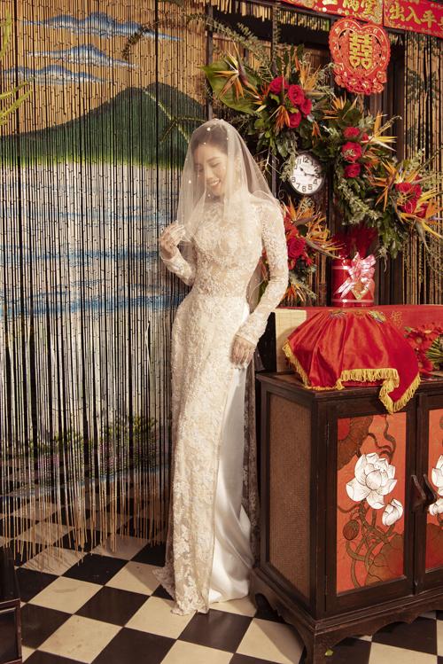 Cô dâu có thể diện thêmvoan cưới khi mặc áo dài.