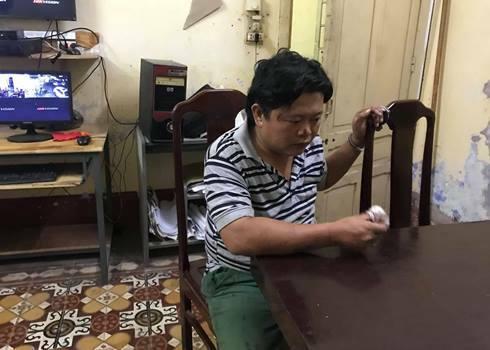 Hồ Vinh Minh Quang tại cơ quan điều tra. Ảnh: Công Quang