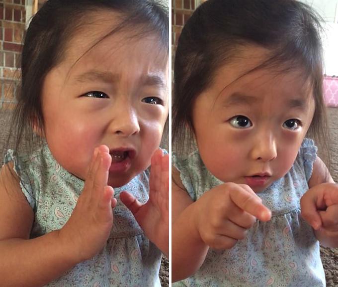 Bé gái dùng điệu bộ đáng yêu để diễn tả lại cảm xúc khi lần đầu gặp bố mẹ nuôi ở bang Texas, Mỹ. Ảnh cắt từ video.