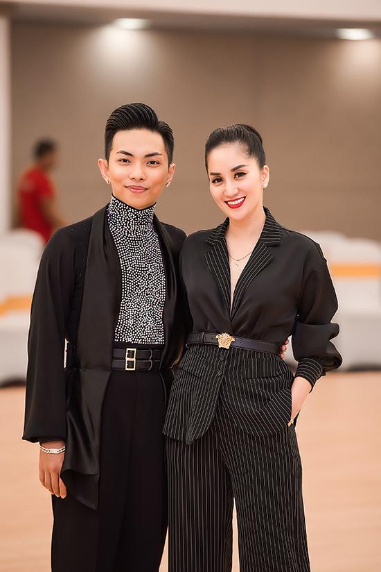 Vợ chồng Khánh Thi ở giải dance sport Thăng Long diễn ra tối 20/10. Ảnh: Trương Gia Huy
