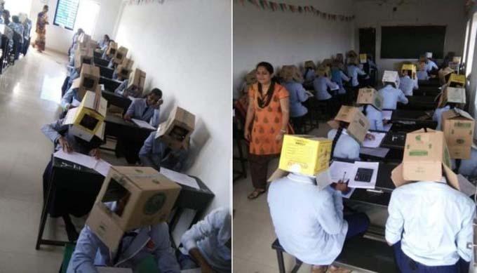 Hình ảnh học sinh trường Bhagat đội thùng các tông trong giờ kiểm tra khiến nhiều người dùng mạng phẫn nộ. Ảnh: BBC.