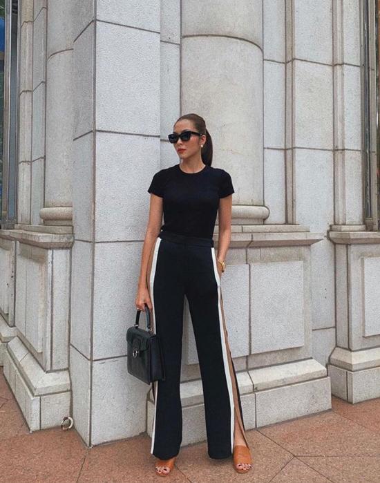 Ngoài cách diện set đồ all black từ trang phục cho đến phụ kiện, Tăng Thanh Hà chọn thêm những kiểu quần xẻ tà, túi da, sandal màu hợp mốt để phối đồ.