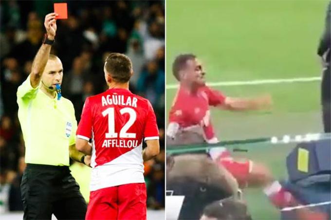 Hành vi phá hoại máy VARcủaAguilar trên đường rời sân bị một fan trên khán đài ghi lại được.