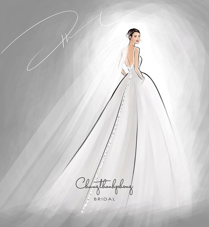 [Caption]Chung Thanh Phong cho biết với chiếc váy cưới đón khách, anh chọn thiết kế hướng tới sự thanh lịch, nhẹ nhàng đúng như những gì mà Đông Nhi kỳ vọng. Để đầm cưới trở nên bắt mắt hơn, nhà mốt đã nhấn nhá thêm hoa 3D làm bằng vải và thêu tay tỉ mỉ, khéo léo.