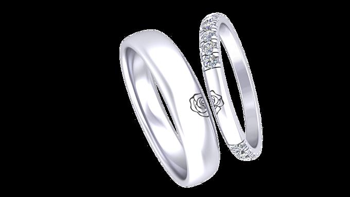 Hình ảnh cánh hoa hồng trên vành nhẫn của cặp sao.