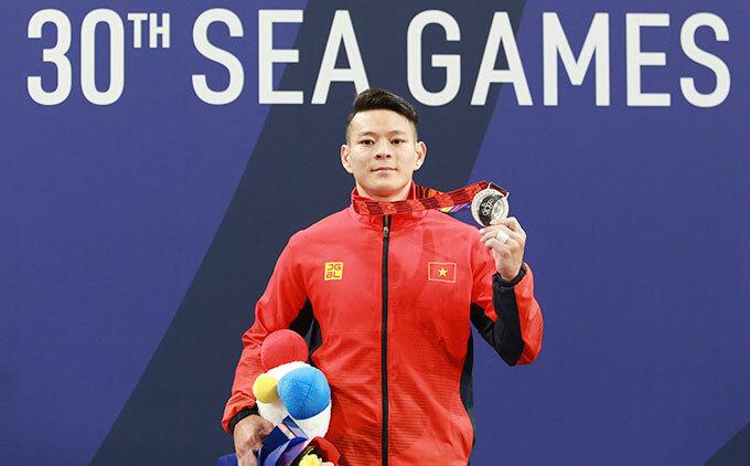 Được đặt nhiều hy vong giành vàng nhưng đô cử Thạch Kim Tuấn chỉ giành HC bạc hạng cân 61 kg.