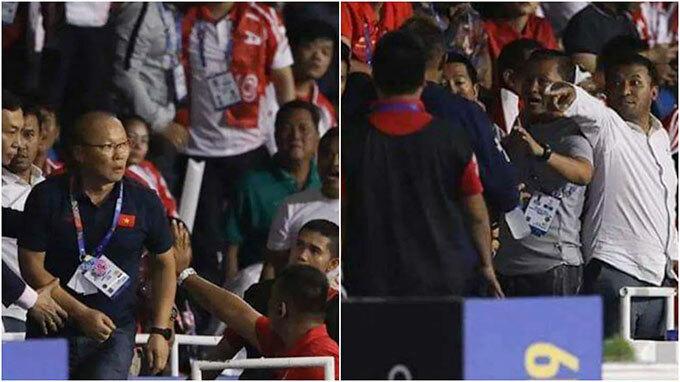 HLV Park và fan Indonesia lời qua tiếng lại trên khán đài. Ảnh: FSA.