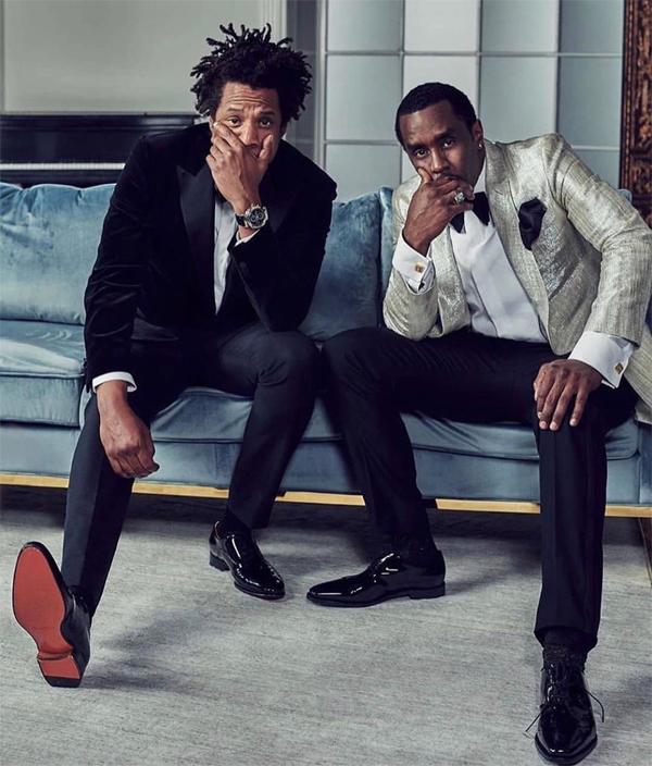 Jay Z chụp ảnh cùng chủ nhân bữa tiệc - rapper Diddy (bên phải).
