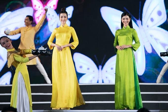 Mỹ Linh (trái) - Kiều Loan diễn thời trang áo dài với vai trò đại sứ tuần Văn hóa Trà và Tơ lụa Bảo Lộc - Lâm Đồng 2019. Đây là là một sự kiện mang đậm bản sắc nghề truyền thống của tỉnh, nằm trong khuôn khổ Festival Hoa Đà Lạt.