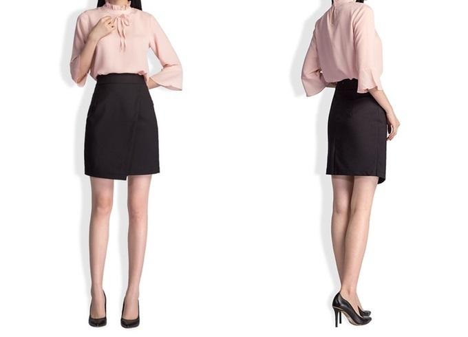 Chân váy dáng bút chì có độ dài ngang gối, tông nâu đậm, vạt trang trí trước và cạp cao. Thiết kế thích hợp với những chị em chuộng phong cách thanh lịch, phù hợp với môi trường công sở. Sản phẩm đang bán chạy trên Shop VnExpress, giá 469.000 đồng