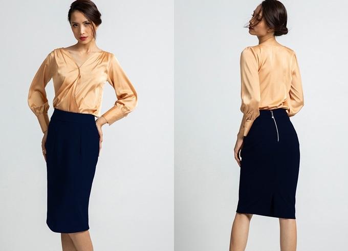 Váy bút chì Hity SKI031 có tông xanh thủy thủ, kiểu dáng thời trang và dễ phối với nhiều trang phục. Thiết kế được lòng nhiều cô gái nhờ vẻ giản dị nhưng tôn vóc dáng. Sản phẩm có giá 799.000 đồng trên Shop VnExpress.