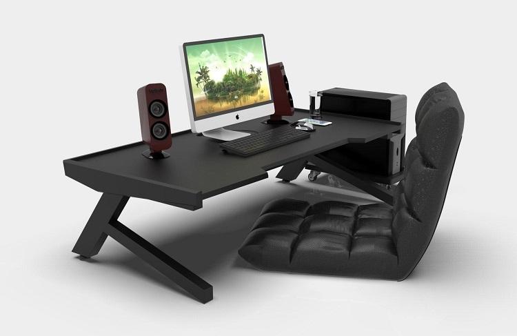 Bàn làm việc K Gaming bệt màu đen cá tính,  thiết kế khác biệt.Thế chân chữ K vững chắc, tạo điểm nhấn mới lạ cho không gian nội thất nhà bạn. Với nhữnggame thủ thích ngồi bệt, muốn cógóc máy đẹp, gọn gàng, đây là lựa chọn lý tưởng.Mặt bàn cókích thước chuẩn là 60 m x 1,2 m, được làm bằng gỗ cao su tự nhiên 100%, chịu sức nặng tốt.Mặt bàn sơn PU 2Kchống nước.Chân bàn làm bằng kim loại, được sơn tĩnh điện chống bong tróc. Sản phẩm đượcthiết kế thêm viền chống rơi vỡ đồ,tạo điểm nhấn cho bàn, phù hợp cho các bạn dùngPC.Chân bàn có thểgấp lại gon gàng để tiện vận chuyển. Sản phẩm có giá 1,62 triệu đồng, ưu đãi 10% trên Shop VnExpress.