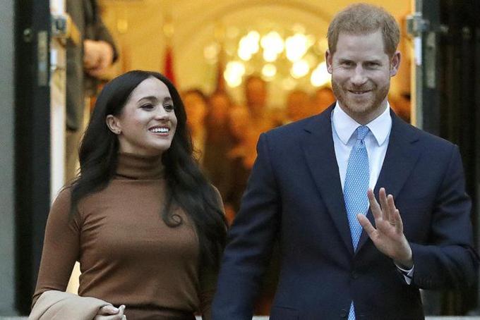 Vợ chồng hoàng tử Harry - Meghan. Ảnh: AFP.