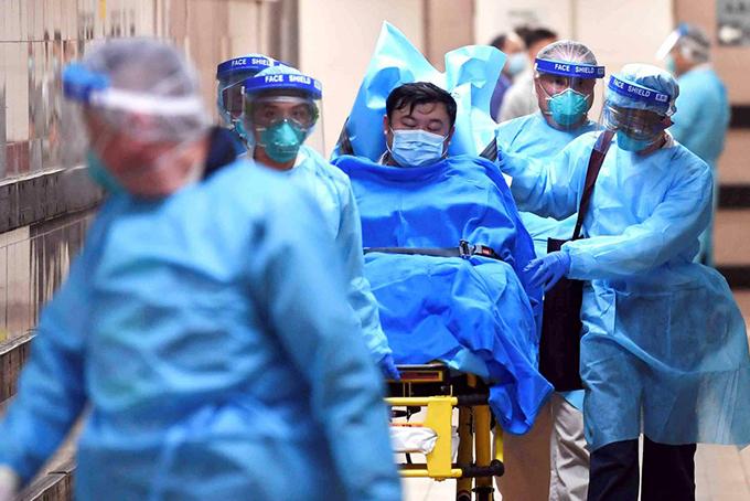 Dịch virus corona làm gián đoạn hoạt động của các công ty tại Trung Quốc. Ảnh: AFP.