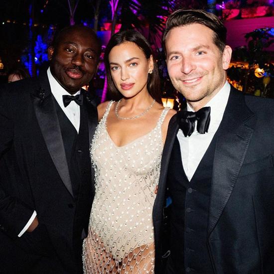 Irina chụp hình với Bradley Cooper (phải) và tổng biên tập tạp chí Vogue.