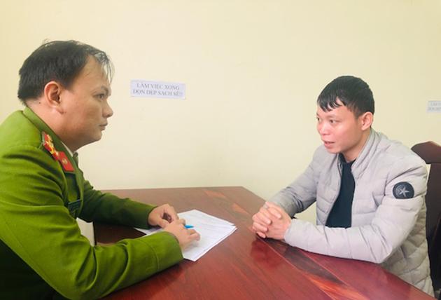 Bị can Lý Văn Quang tại cơ quan điều tra. Ảnh: Công an cung cấp.