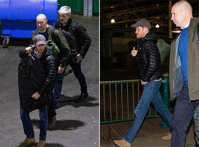 Harry được hai nhân viên an ninh hộ tống khi từ Canada trở về Anh. Ảnh: Splashnews.