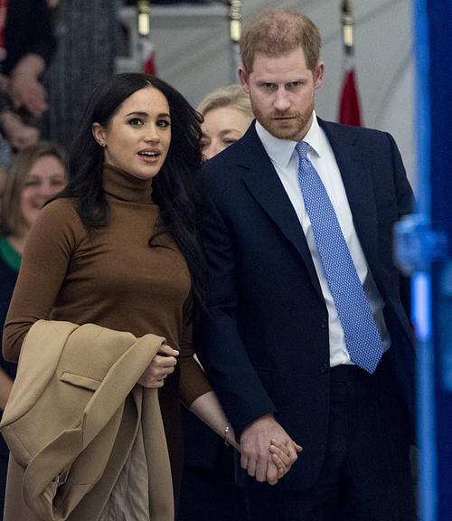 Vợ chồng Harry trong sự kiện cuối trước khi tuyên bố rút khỏi các nhiệm vụ hoàng gia hồi tháng trước. Ảnh: UK Press.