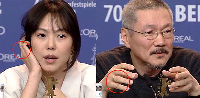 Cặp đôi đeo nhẫn đôi ở ngón áp út, cho thấy giữa họ đã có sự đính ước. Điều này trái với tin đồn Kim Min Hee và Hong Sang Soo chia tay.