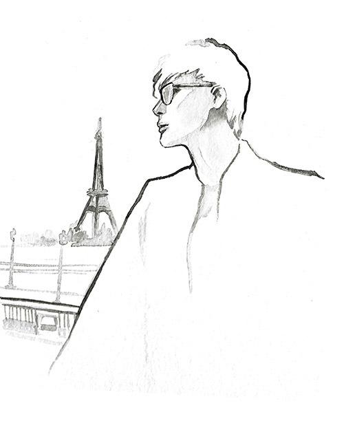 Hình ảnh chàng ca sĩ trầm tư trên đường phố Paris, phía xa là tháp Eiffel - biểu tượng của nước Pháp.