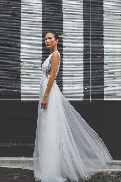 Điểm nổi bật trong phong cách cá nhân của Trương Thanh Hải là các váy cưới có khoảng cut-out tinh tế mà gợi cảm, tôn nét đẹp cô dâu.