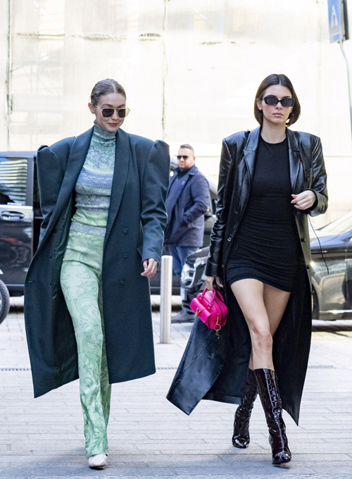 She was pictured with best friend Kendall Jenner, 24, the following day once again not revealing her body by wearing a large jacket. Walking side-by-side to the Keeping Up with the Kardashians star, Gigi rocked a teal calf-length trench coat over her green jumpsuit.