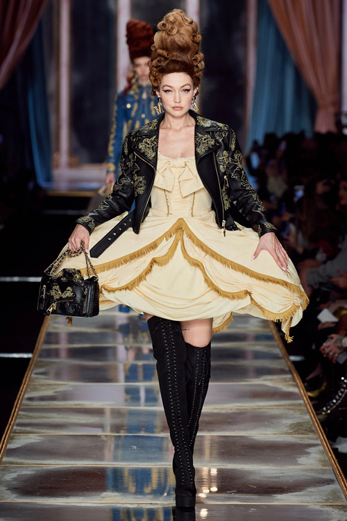 On February 20, Gigi wore a knee-length oversized floral dress during the Moschino fashion show for Milan Fashion Week.