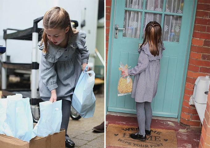 Công chúa Charlotte xách những túi đồ ăn đi trao cho những người cần giúp đỡ ở hạt Norfork, Anh, hồi cuối tháng 4. Ảnh: Kate Middleton.