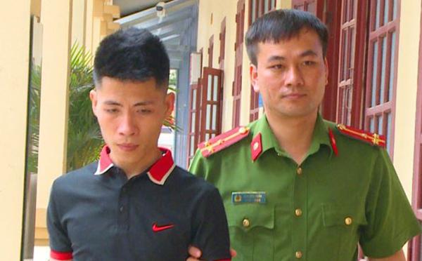 Cảnh sát bắt nghi can Trần Quốc Tuấn.