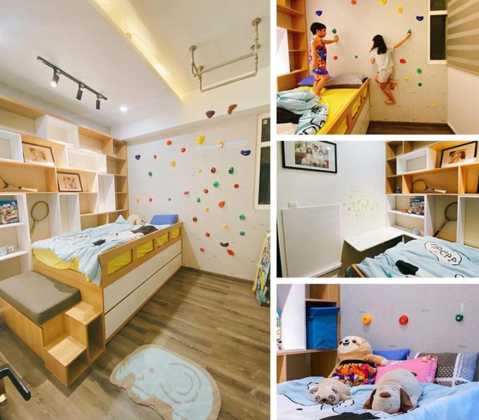 Phòng ngủ còn kiêm sân chơi cho hai con của nhạc sĩ với tường leo. Bộ giường tủ đa năng giúp các bé vừa ngủ, chứa đồ chơi, quần áo, học bài.