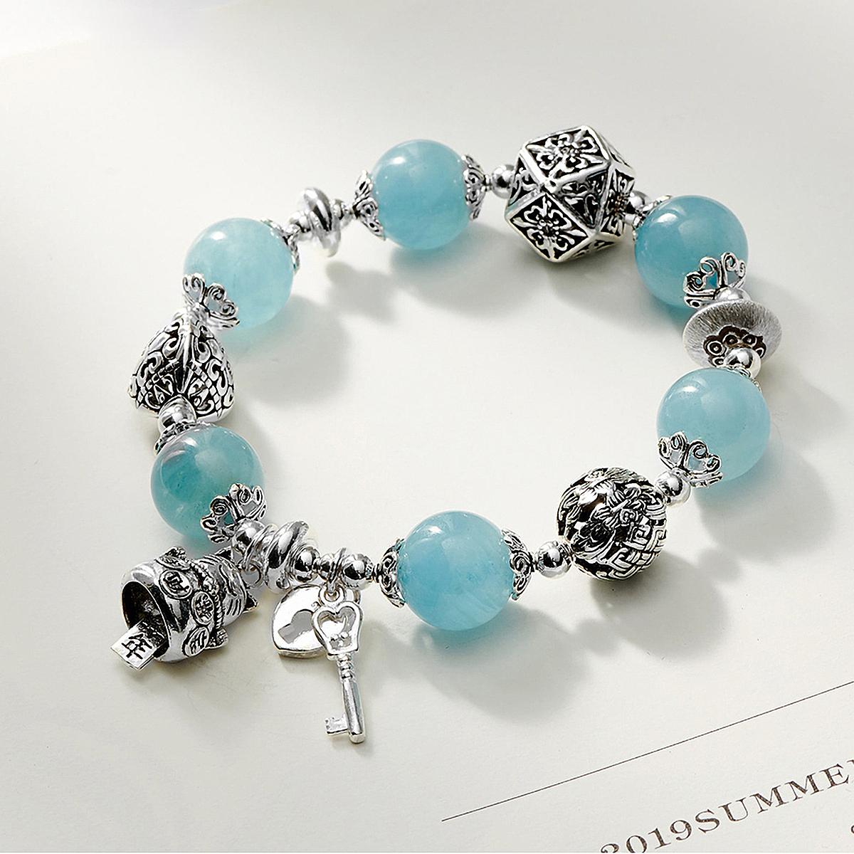 Vòng tay đá Aquamarine phối charm bạc size hạt 12 mm thủy, mộc - Ngọc Quý Gemstones - xanh dương giảm 20% còn 1,8 triệu đồng; làm từ chất liệu đá Hải Lam Ngọc tự nhiên, kích thước 52 mm; thích hợp làm quà tặng.