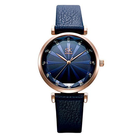 Đồng hồ nữ chính hãng Shengke UK K0099L 499.000 đồng; dây da chính hãng; chất liệu viền ngoài bằng thép không gỉ; đường kính 29,5 mm, kích thước dây 14 mm.