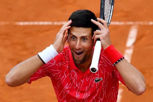 Djokovic nhận nhiều chỉ trích sau khi nhiều đồng nghiệp dự giải đấu anh tổ chức dương tính với nCoV. Ảnh: AFP.