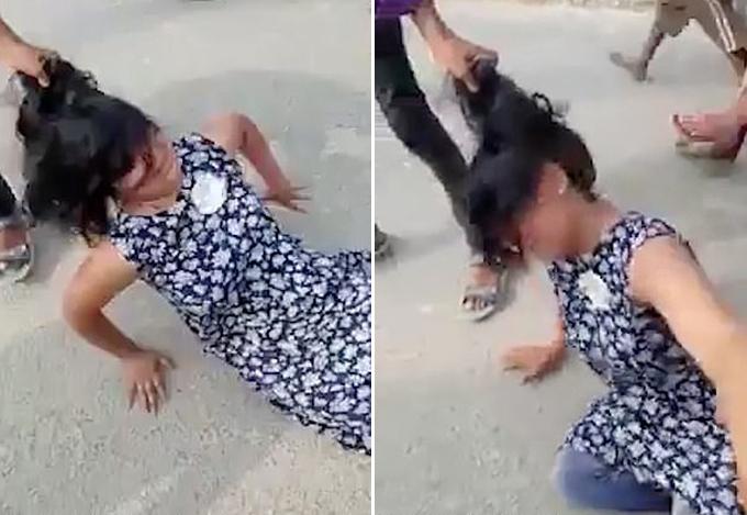 Người phụ nữ bị chồng giật tóc vì cản anh ta lấy thêm vợ ở làng  Hussaina Khurd, huyện Vaishali, bang Bihar, Ấn Độ hôm 24/5. Ảnh cắt từ video.