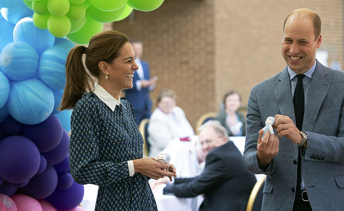 Kate Middleton dresses in NHS blue as she and Prince William visit Norfolk hospital to mark the health services 72nd birthday