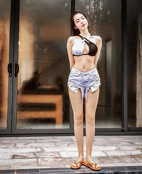 Elly Trần chuộng mặc đồ kiệm vải - 16