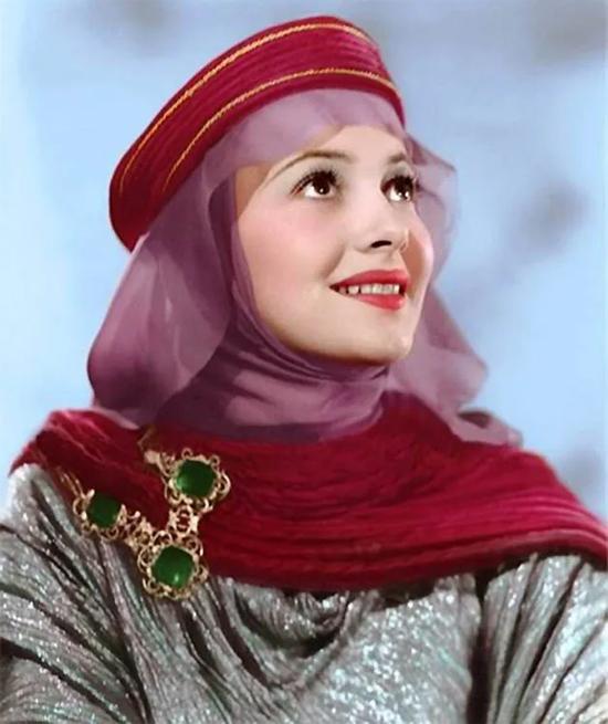 Năm 1938, cô tiếp tục ghi dấu ấn với vai người đẹp trong phim The Adventures of Robin Hood.