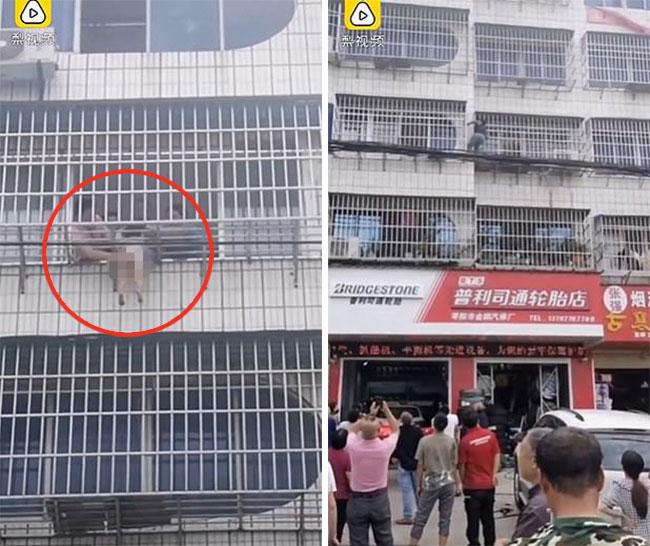Người dân giải cứu bé gái 5 tuổi bị mắc kẹt ở chuồng cọp khu dân cư tại huyện Tảo Dương, tỉnh Hồ Bắc, Trung Quốc. Ảnh cắt từ video.