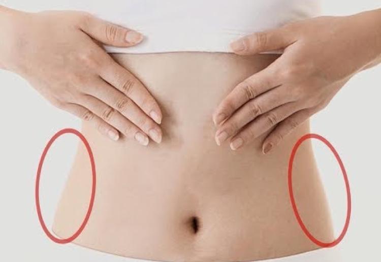 Massage đúng cách để tác động vào vũng mờ thừa ở bụng.