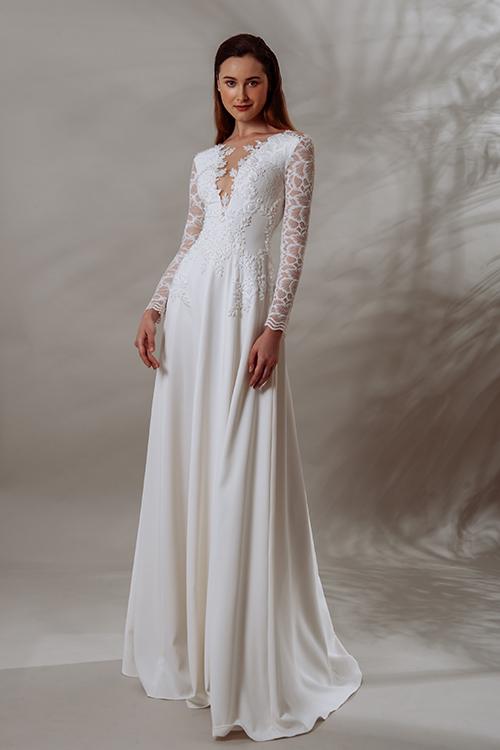 Váy Anthea có dáng chữ A, tay dài phối ren và cổ V xẻ sâu. Thân áo được đính kín hoa văn ren nhỏ li ti.