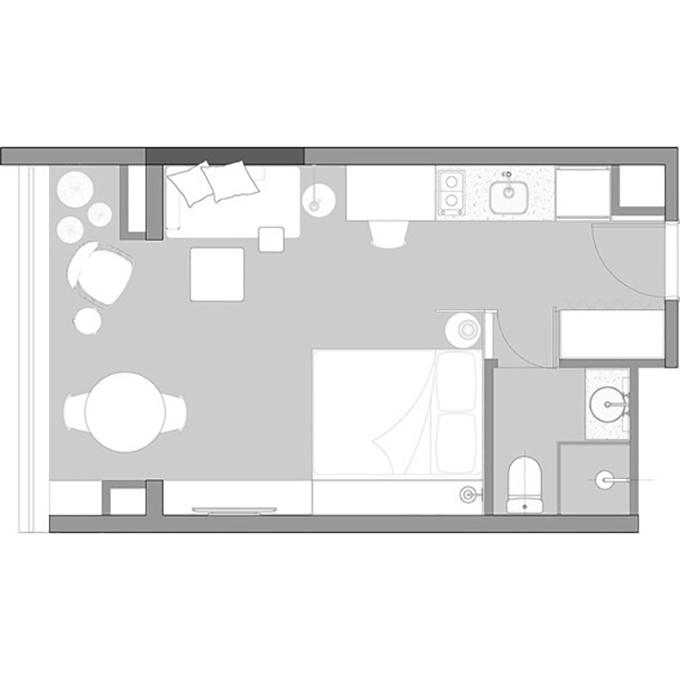 Để tạo ra hai phòng tách biệt, giường được đặt ở một góc của căn hộ.