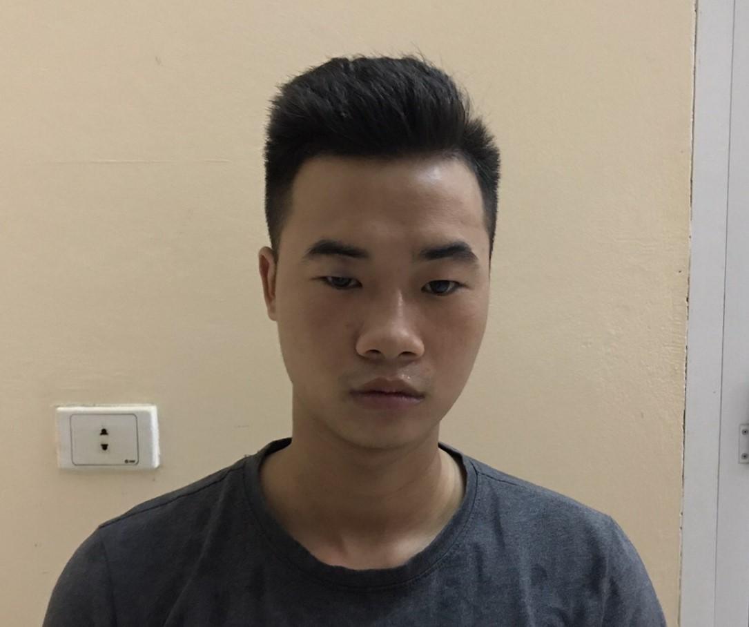 Hoàng Văn Dương tại cơ quan điều tra. Ảnh: C.A