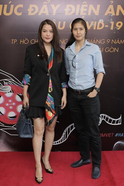 Tại các hoạt động về điện ảnh trong nước gần đây, diễn viên - nhà sản xuất Trương Ngọc Ánh thường xuyên đi chung với nhà làm phim Việt kiều Jessica Ngô (phải). Bộ đôi đang hợp tác làm phim huyền sử - võ thuật Trung Vương.