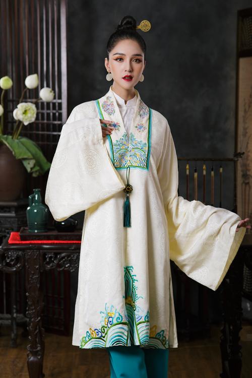 Một thiết kế khác mang sắc trắng - xanh chủ đạo phù hợp với các nàng yêu vẻ đẹp đằm thắm, nhẹ nhàng,