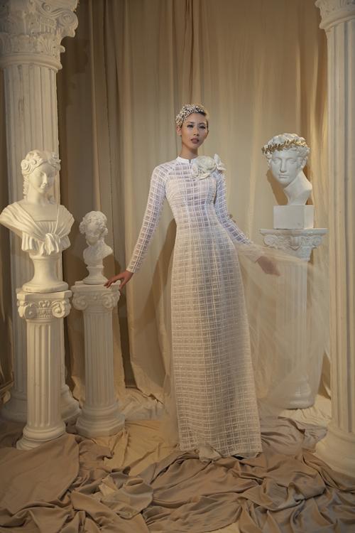 Áo dài đơn giản với vải họa tiết kẻ ô cho cô dâu chuộng sự thanh lịch.