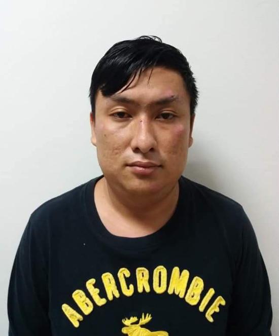 Lê Dương Thành Long tại cơ quan điều tra. Ảnh: Công an cung cấp.
