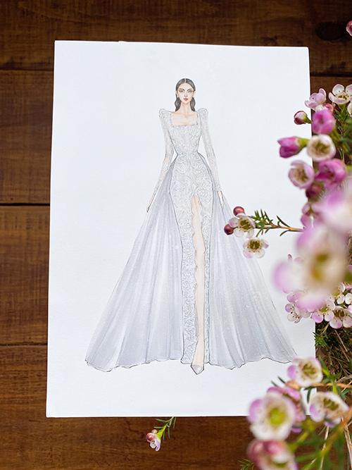 Cận cảnh bản phác thảo váy cưới. Để chuẩn bị hai mẫu đầm cho Thuỳ An, NTK cùng 4 cộng sự đã dành khoảng 2 tháng làm việc liên tục, đảm bảo cho từng chi tiết, đường nét váy cưới hoàn hảo chỉn chu cho ngày trọng đại của người đẹp.